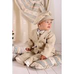 Классический костюм на мальчика бежевого цвета